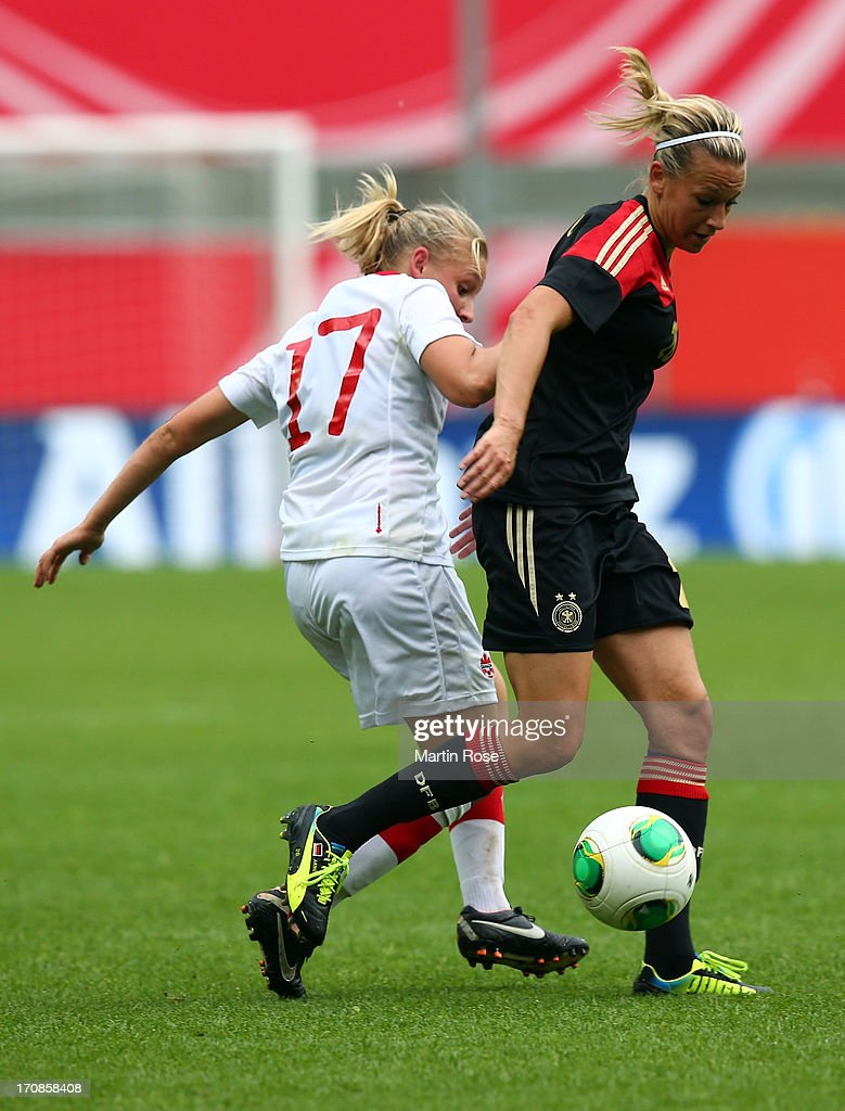 Lena Goessling (R) of Germany and Melissa Busque of Canada battle for the ball during the Women's International Friendly match between Germany and Canada at Benteler Arena on June 19, 2013 in Paderborn, Germany.