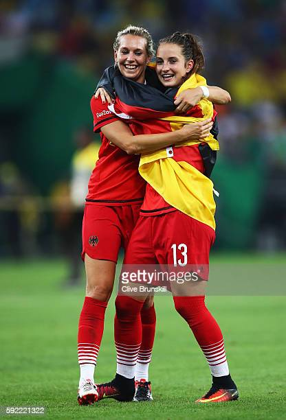 Lena Goessling of Germany and Sara Dabritz of Germany celebrate at the end of the Women's Olympic Gold Medal match between Sweden and Germany at...