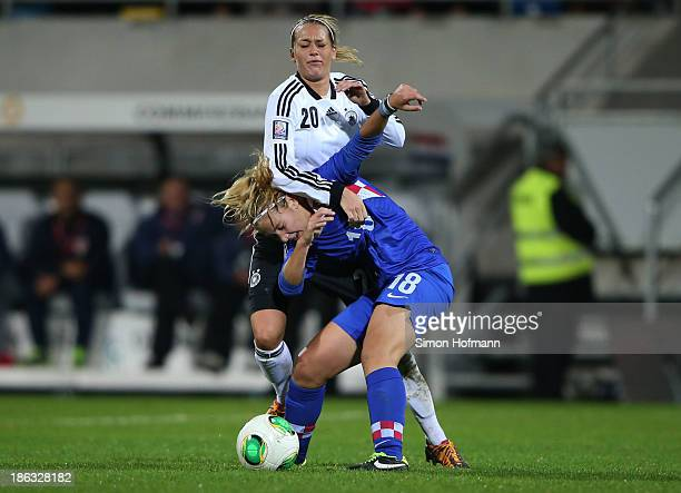 Lena Goessling of Germany is challenged by Gabrijela Gaiser of Croatia during the FIFA Women's Worldcup 2015 Qualifier match between Germany and...