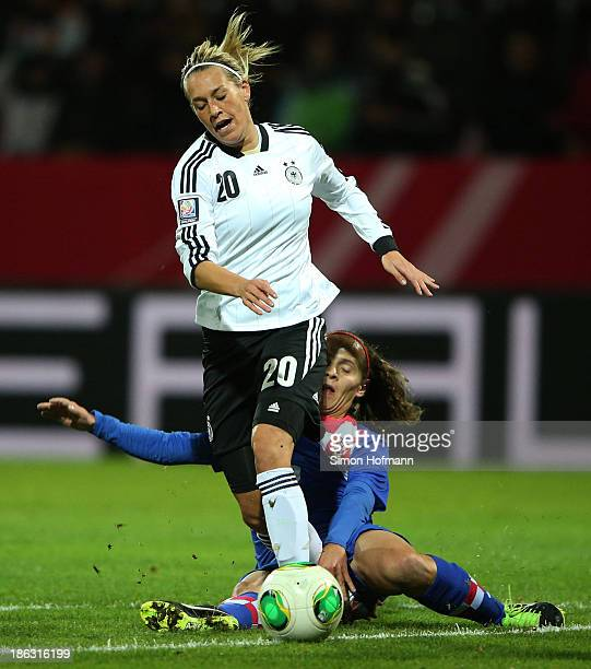Lena Goessling of Germany is challenged by Kristina Nevrkla of Croatia during the FIFA Women's Worldcup 2015 Qualifier match between Germany and...