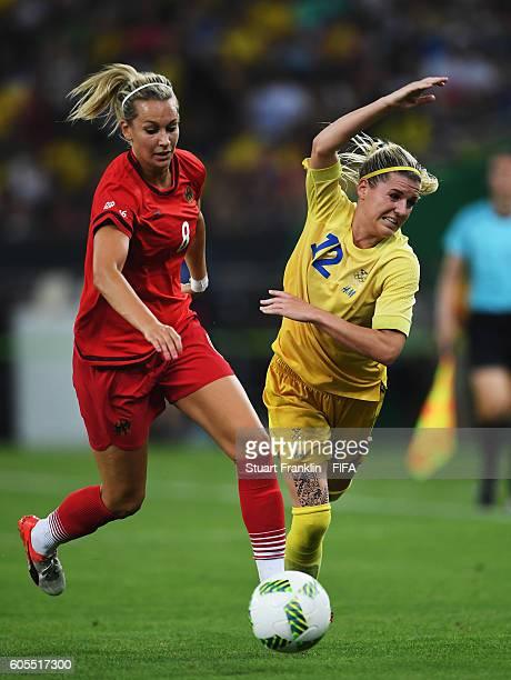 Lena Goessling of Germany is challenged by Olivia Schough of Sweden during the Olympic Women's Football final between Sweden and Germany at Maracana...