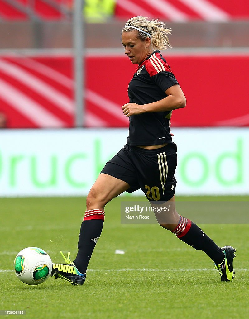 <a gi-track='captionPersonalityLinkClicked' href=/galleries/search?phrase=Lena+Goessling&family=editorial&specificpeople=639252 ng-click='$event.stopPropagation()'>Lena Goessling</a> of Germany runs with the ball during the Women's International Friendly match between Germany and Canada at Benteler Arena on June 19, 2013 in Paderborn, Germany.