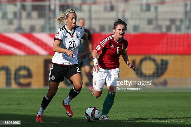 Lena Goessling of Germany vies with Angela HummelSmuczer of Hungary during the UEFA Women's Euro 2017 Qualifier between Germany and Hungary at Erdgas...