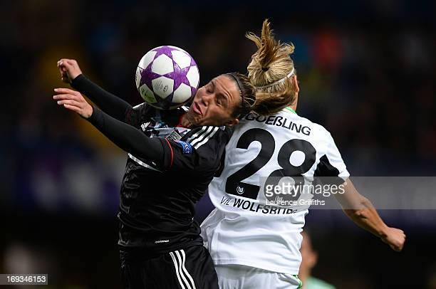 Lena Goessling of VfL Wolfsburg and Camille Abily of Olympique Lyonnais compete for the header during the UEFA Women's Champions League Final Match...