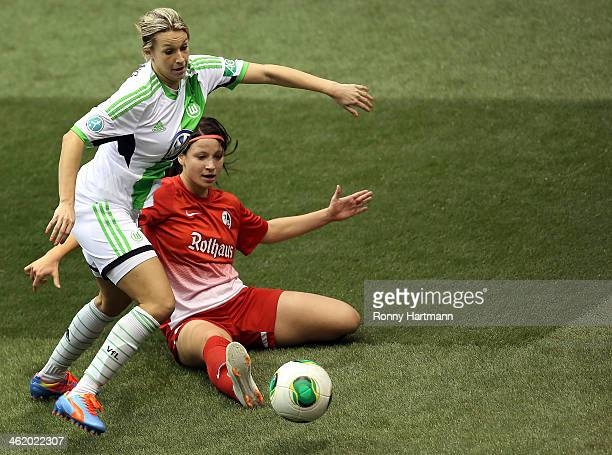 Lena Goessling of VfL Wolfsburg and Sylvia Arnold of SC Freiburg battle for the ball during the DFB Women's Indoor Cup 2013 at GETECArena on January...
