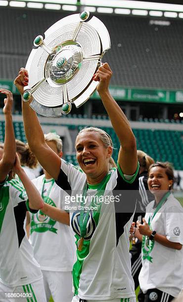 Lena Goessling of Wolfsburg celebrates with the trophy after winning the German Championship after the Women's Bundesliga match between VfL Wolfsburg...