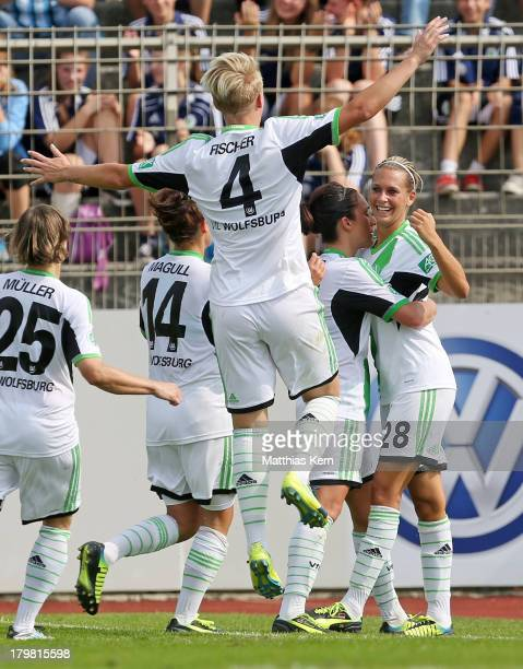 Lena Goessling of Wolfsburg jubilates with team mates after scoring the second goal during the Women's Bundesliga match between VFL Wolfsburg and FC...