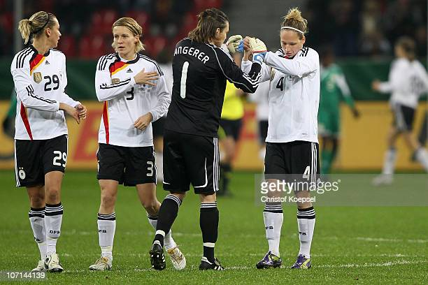 Lena Goessling Saskia Bartusiak Nadine Angerer and Babett Peter of Germany celebrate their first goal during the women's international friendly match...
