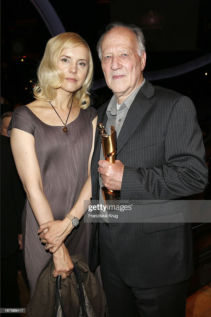 Lena Herzog and <a gi-track='captionPersonalityLinkClicked' href=/galleries/search?phrase=Werner+Herzog&family=editorial&specificpeople=213922 ng-click='$event.stopPropagation()'>Werner Herzog</a> with honor award at the Lola German Film Award 2013 at Friedrichstadt-Palast on April 26, 2013 in Berlin, Germany.