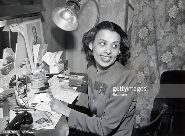 Lena Horne noted black singer and entertainer reads a personal note at her dressing table before preparing for a show Photograph 1940's