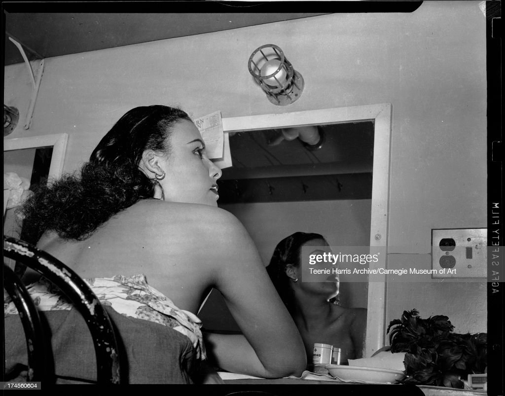 Lena Horne reflected in mirror in dressing room at Stanley Theatre, Pittsburgh, Pennsylvania, c. 1944.