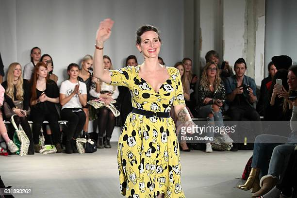 Lena Hoschek acknowledges the applause of the audience after her show during the MercedesBenz Fashion Week Berlin A/W 2017 at Kaufhaus Jandorf on...