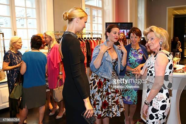 Lena Hoschek and Elisabeth Guertler watch a model during the Escada 'Fete Imperiale' 2015 on June 2 2015 in Vienna Austria