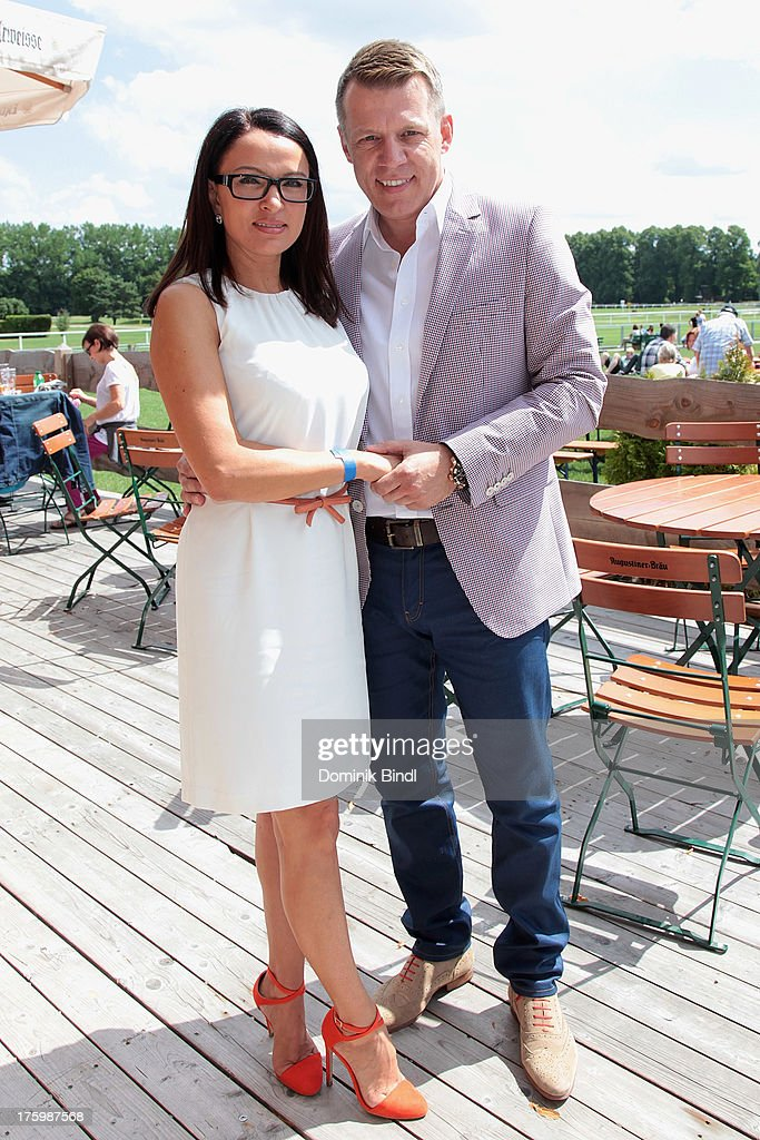 Lena Kahn and Axel Kahn attend the EAGLES charity homepage relaunch at Galopprennbahn Riem on August 11, 2013 in Munich, Germany.