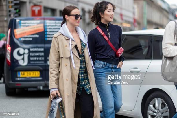 Lena Lademann wearing a trench coat outside Baum Und Pferdgarten on August 10 2017 in Copenhagen Denmark