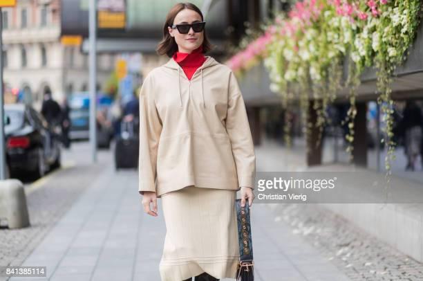 Lena Lademann wearing beige hooded jacket and skirt black overknees outside Jennifer Bloom on August 31 2017 in Stockholm Sweden