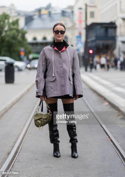 Lena Lademann wearing black overknees checked jacket outside Rodebjer on August 30 2017 in Stockholm Sweden