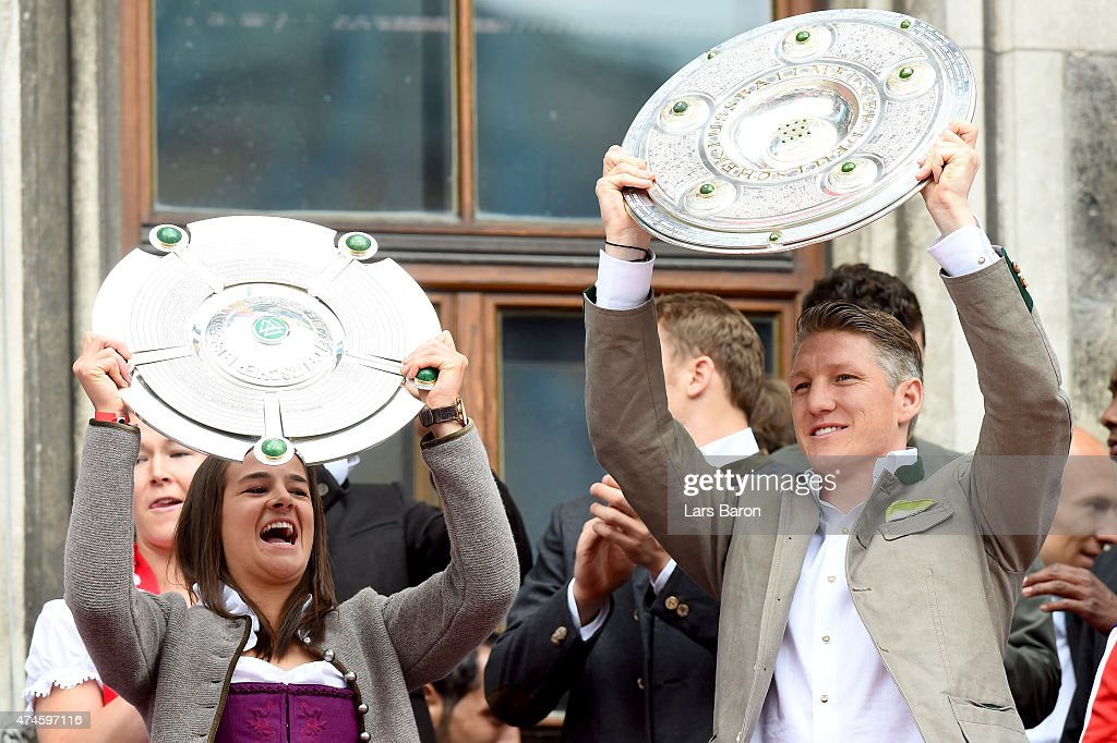 Lena Lotzen and Bastian Schweinsteiger celebrate winning the Bundesliga at Marienplatz on May 24, 2015 in Munich, Germany.