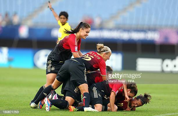 Lena Lotzen of Germany celebrate with her team mates after she schores her team's opening goal during the FIFA U20 Women's World Cup 2012 group D...