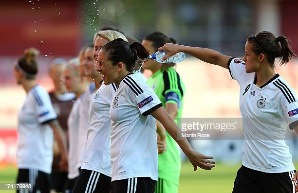 Lena Lotzen of Germany celebrate with team mate Nadine Kessler after the UEFA Women's Euro 2013 quarter final match between Italy and Germany at...