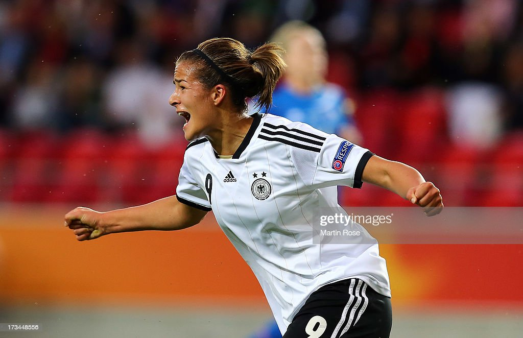 <a gi-track='captionPersonalityLinkClicked' href=/galleries/search?phrase=Lena+Lotzen&family=editorial&specificpeople=4620343 ng-click='$event.stopPropagation()'>Lena Lotzen</a> of Germany celebrates after she scores her team's opening goal during the UEFA Women's Euro 2013 group B match between Iceland and Germany at Vaxjo Arena on July 14, 2013 in Vaxjo, Sweden.