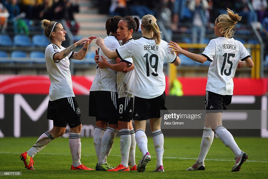 Lena Lotzen (2L) of Germany celebrates his team's third goal with team mates during the FIFA Women's World Cup 2015 qualifying match between Germany and Slovenia at Carl-Benz-Stadion on April 10, 2014 in Mannheim, Germany.