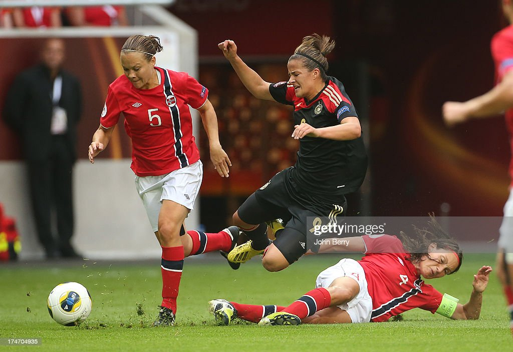 Lena Lotzen of Germany fights for the ball between Toril Akerhaugen and Ingvild Stensland of Norway during the UEFA Women's Euro 2013 Final between Germany and Norway at the Friends Arena Stadium on July 28, 2013 in Solna, Sweden.
