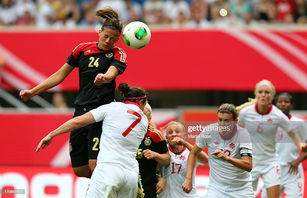 Lena Lotzen (L) of Germany head at goal during the Women's International Friendly match between Germany and Canada at Benteler Arena on June 19, 2013 in Paderborn, Germany.