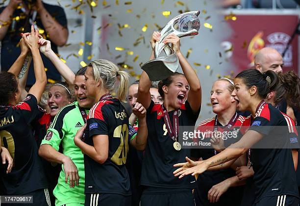 Lena Lotzen of Germany lifts the trophy after the UEFA Women's EURO 2013 final match between Germany and Norway at Friends Arena on July 28 2013 in...