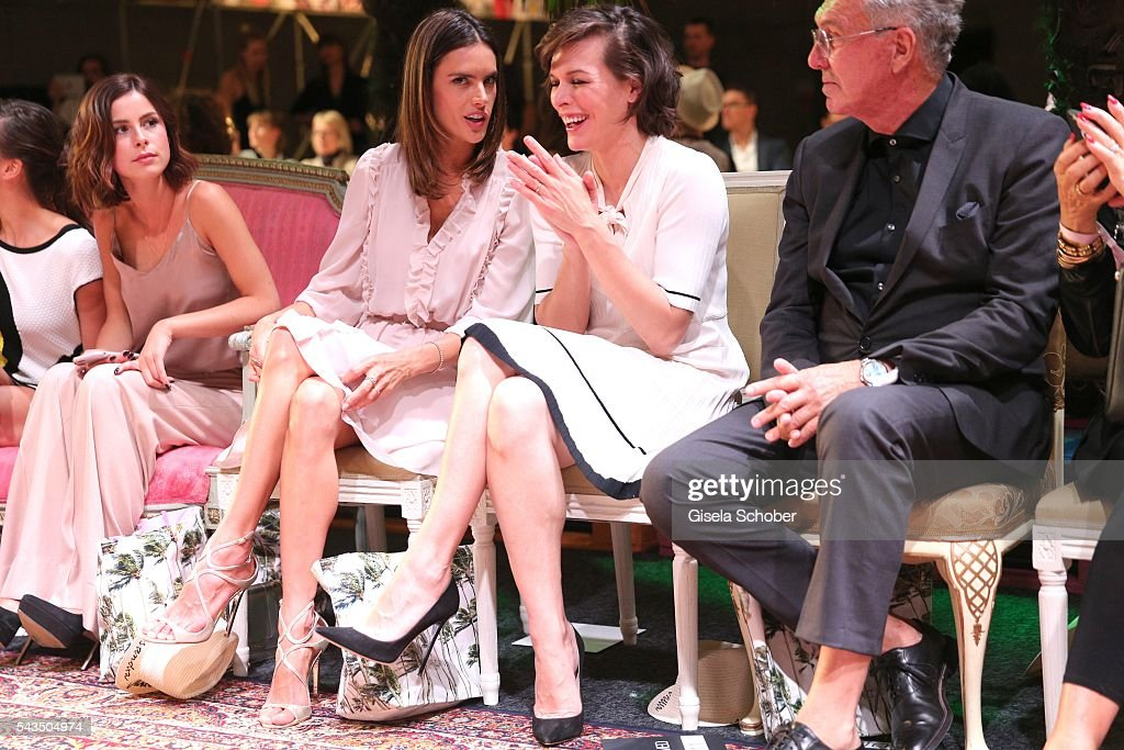 Lena Meyer-Landrut, Alessandra Ambrosio and Milla Jovovich and Helmut Schlotterer, Founder and CEO of Marc Cain during the Marc Cain fashion show spring/summer 2017 at CITY CUBE Panorama Bar on June 28, 2016 in Berlin, Germany.