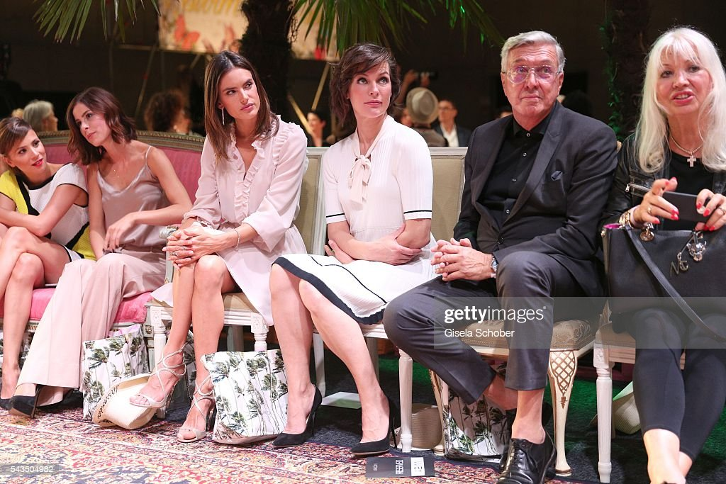 Lena Meyer-Landrut, Alessandra Ambrosio, Milla Jovovich, Helmut Schlotterer, Founder and CEO of Marc Cain and his wife Ute Schlotterer during the Marc Cain fashion show spring/summer 2017 at CITY CUBE Panorama Bar on June 28, 2016 in Berlin, Germany.