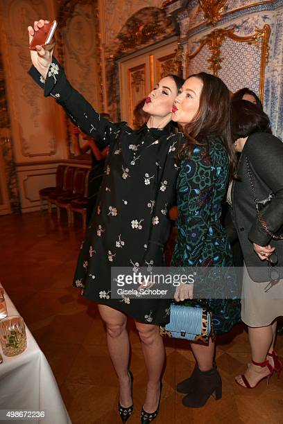 Lena MeyerLandrut and Hannah Herzsprung shoot a selfie during the mytheresacom X Gianvito Rossi dinner at St Emmeram Castle on November 19 2015 in...