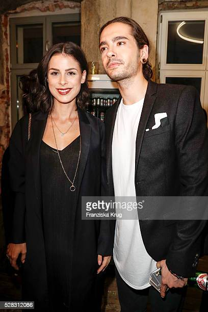 Lena MeyerLandrut and Tom Kaulitz guitarist of the band Tokio Hotel and brother of Bill Kaulitz during the photo art exhibition and book launch of...