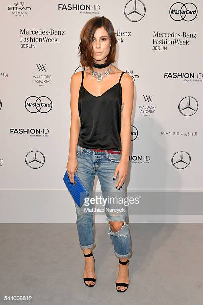 Lena MeyerLandrut attends the 'Designer for Tomorrow' show during the MercedesBenz Fashion Week Berlin Spring/Summer 2017 at Erika Hess Eisstadion on...