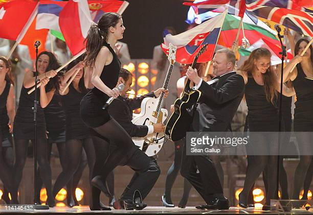 Lena MeyerLandrut of Germany and cohost Stefan Raab perform during the dress rehearsal ahead of the finals of the 2011 Eurovision Song Contest on May...