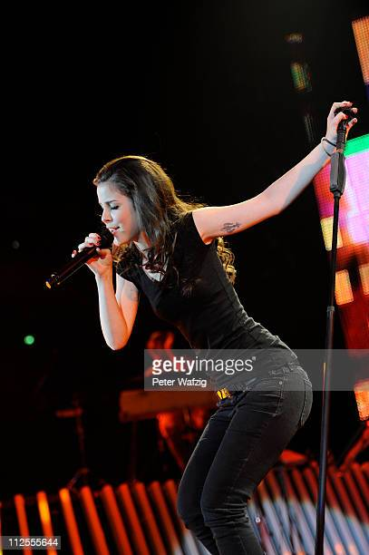 Lena MeyerLandrut performs on stage at the Westfalen Stadium on April 19 2011 in Dortmund Germany