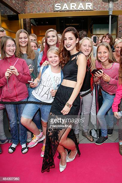 Lena MeyerLandrut poses with fans during the Late Night Shopping Designer Outlet Soltau on August 28 2014 in Soltau Germany