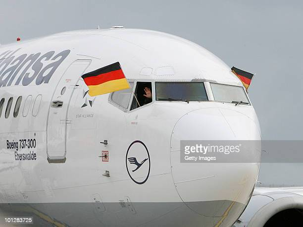 Lena MeyerLandrut winner of the Eurovision Song Contest 2010 arrives in a Lufthansa plane with German flags outside at Hanover airport on May 30 2010...
