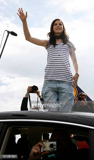 Lena MeyerLandrut winner of the Eurovision Song Contest 2010 waves at her fans during her arrival at Hanover airport on May 30 2010 in Hanover...