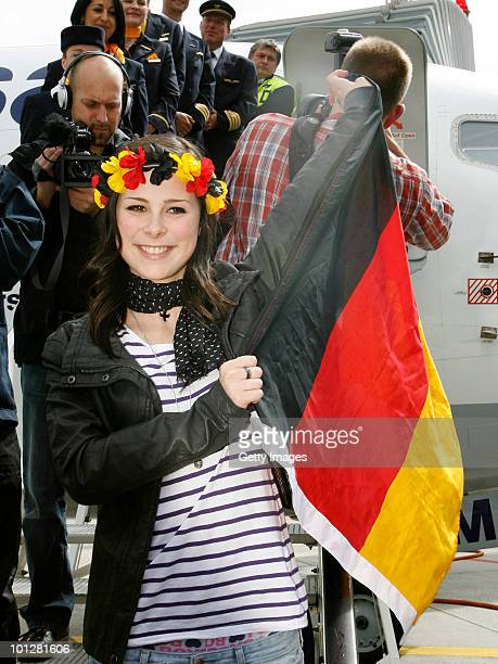 Lena MeyerLandrut winner of the Eurovision Song Contest 2010 jubilates with the German flag during her arrival at Hanover airport on May 30 2010 in...
