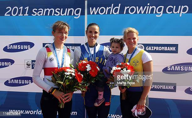 Lena Mueller of Germany Fabiana Beltrame of Brazil and Emma Fred of Sweden celebrate on the podium after the wome's lightweight single sculls final...