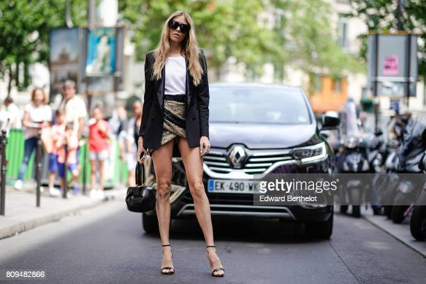 Lena Perminova wears a black blazer jacket a white tshirt a skirt heels outside the Elie Saab show during Paris Fashion Week Haute Couture...