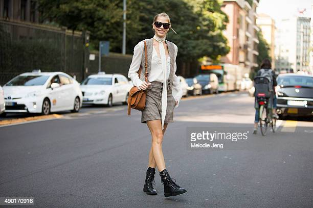Lena Perminova wears a Chloe outfit with flat leather Giuseppe Zanotti boots uring the Milan Fashion Week Spring/Summer 16 on September 26 2015 in...