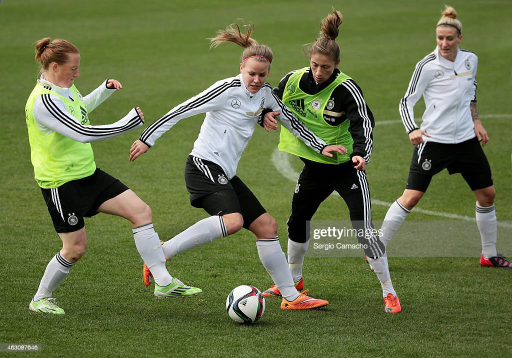 Lena Petermann (2nd L) duels for the ball with Melanie Behringer (L) and Bianca Schmidt during a Germany Women's Training Session at Marbella Football Center on February 9, 2015 in Marbella, Spain.