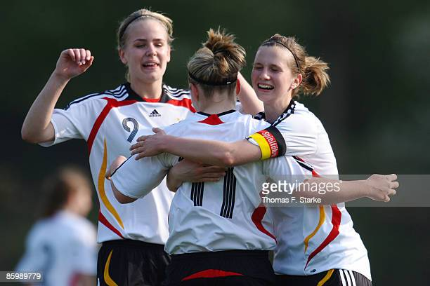 Lena Petermann Jacqueline de Backer and Annabel Jaeger of Germany celebrate during the women's U15 International friendly match between Germany and...