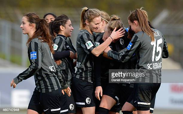 Lena Petermann of Freiburg celebrates her team's fith goal with team mates during the Women's DFB Cup Quarter Final match between SC Freiburg and FSV...