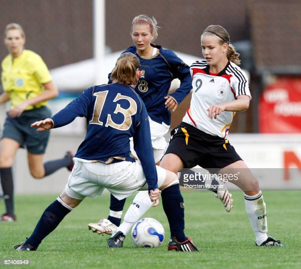 Lena Petermann of Germany battles for the ball with Susan Hutchinson of Scotland during the Women U15 international friendly match between Germany...