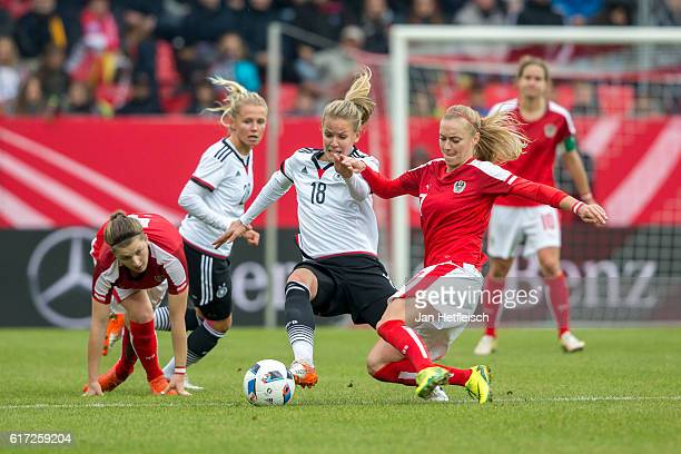 Lena Petermann of Germany battles with Carina Wenninger of Austria during the Women's International Friendly match between Germany and Austria at the...