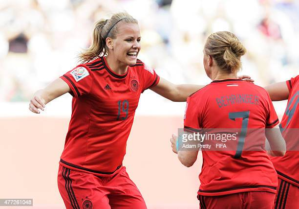 Lena Petermann of Germany celebrates with Melanie Behringer of Germany after scoring a goal during the FIFA Women's World Cup 2015 Group B match...