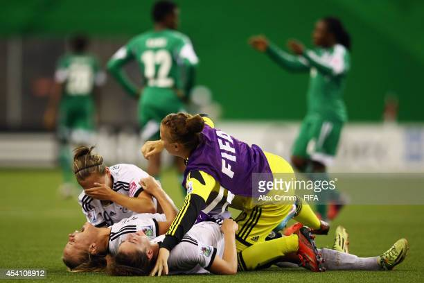 Lena Petermann of Germany celebrates with team mates after winning the FIFA U20 Women's World Cup Canada 2014 final match between Nigeria and Germany...